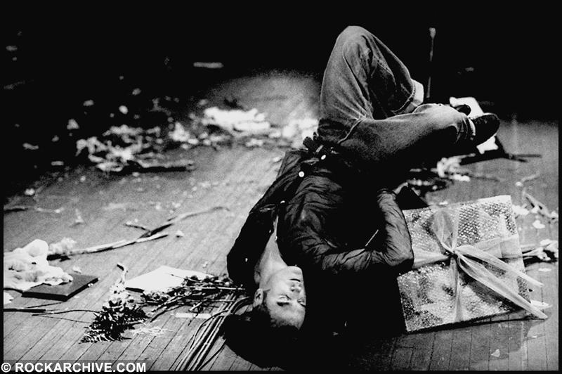 Morrissey performing upside down on a monitor duing his Kill Unce Tour at the Jones Beach Theatre, Wantagh, New York in July 1991.  Shot by © Kevin Cummins - (This image is available to buy below)