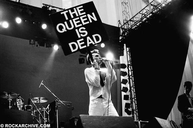 Morrissey wields a protestor's placard bearing the title of The Smiths anarchic 'Queen is Dead' tour and album. Shot by © Gary Lornie at the GMex Centre during the Festival of the 10th Summer in July 1986 - (This image is available to buy below)