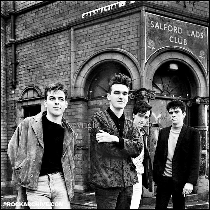 The image of The Smiths outside Salford Lads' Club that graces the inner sleeve of their classic album The Queen is Dead. Photo by © Stephen Wright - (This image is available to buy below)