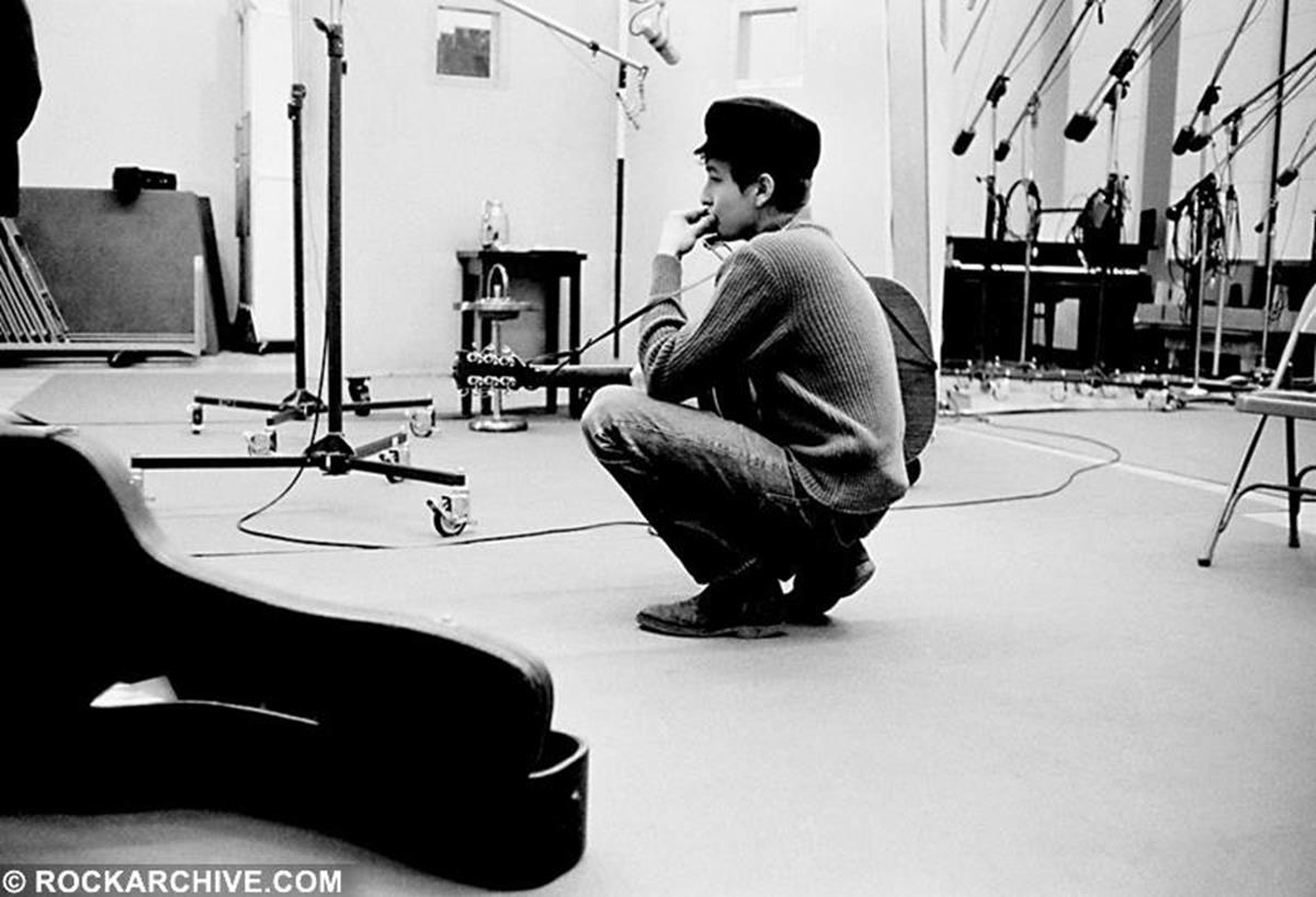 At Columbia Studios, New York 1963 Bob Dylan tunes his guitar during a recording session for his second studio album 'Free Wheelin'. © Don Hunstein