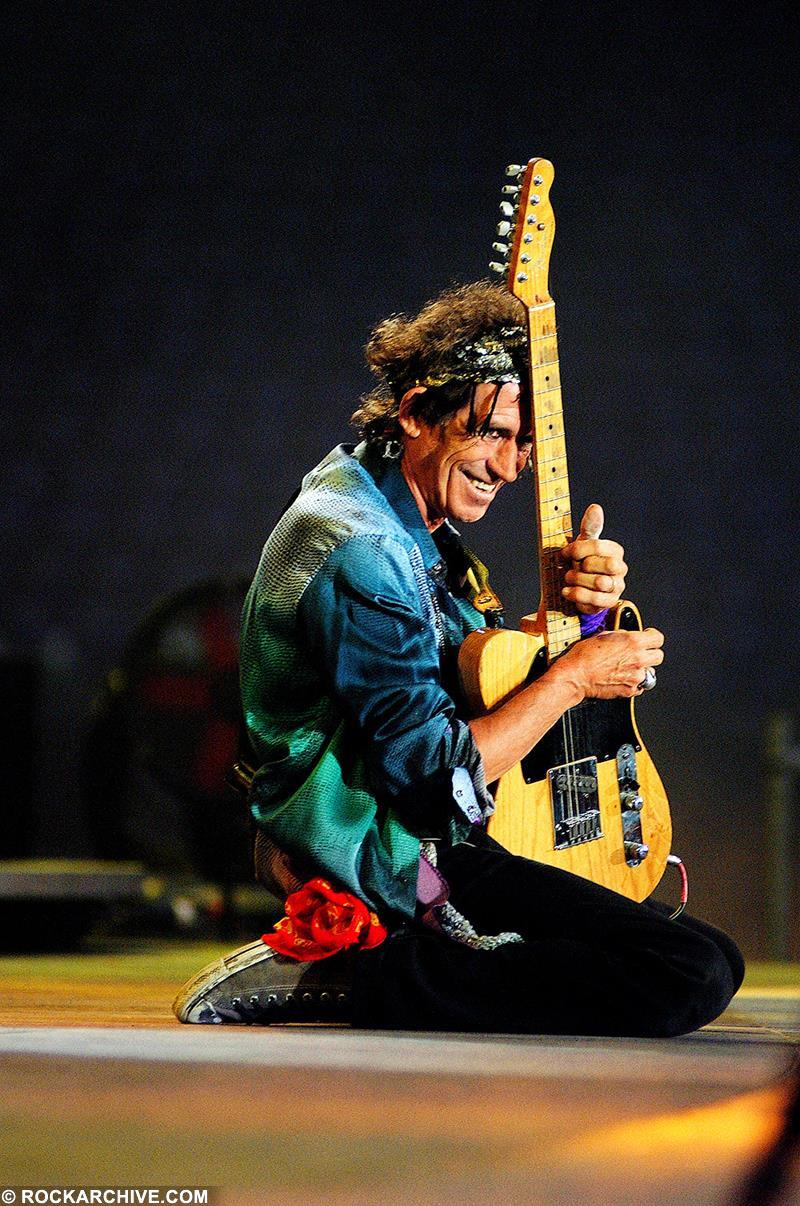 Keith Richards performing with The Rolling Stones onstage at the Feyenoordstadion Rotterdam, Holland in August 2003. © Dimitri Hakke