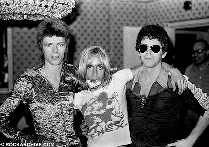 David Bowie, Lou Reed & Iggy Pop during a press conference at the Dorchester Hotel, London in July 1972. © Mick Rock