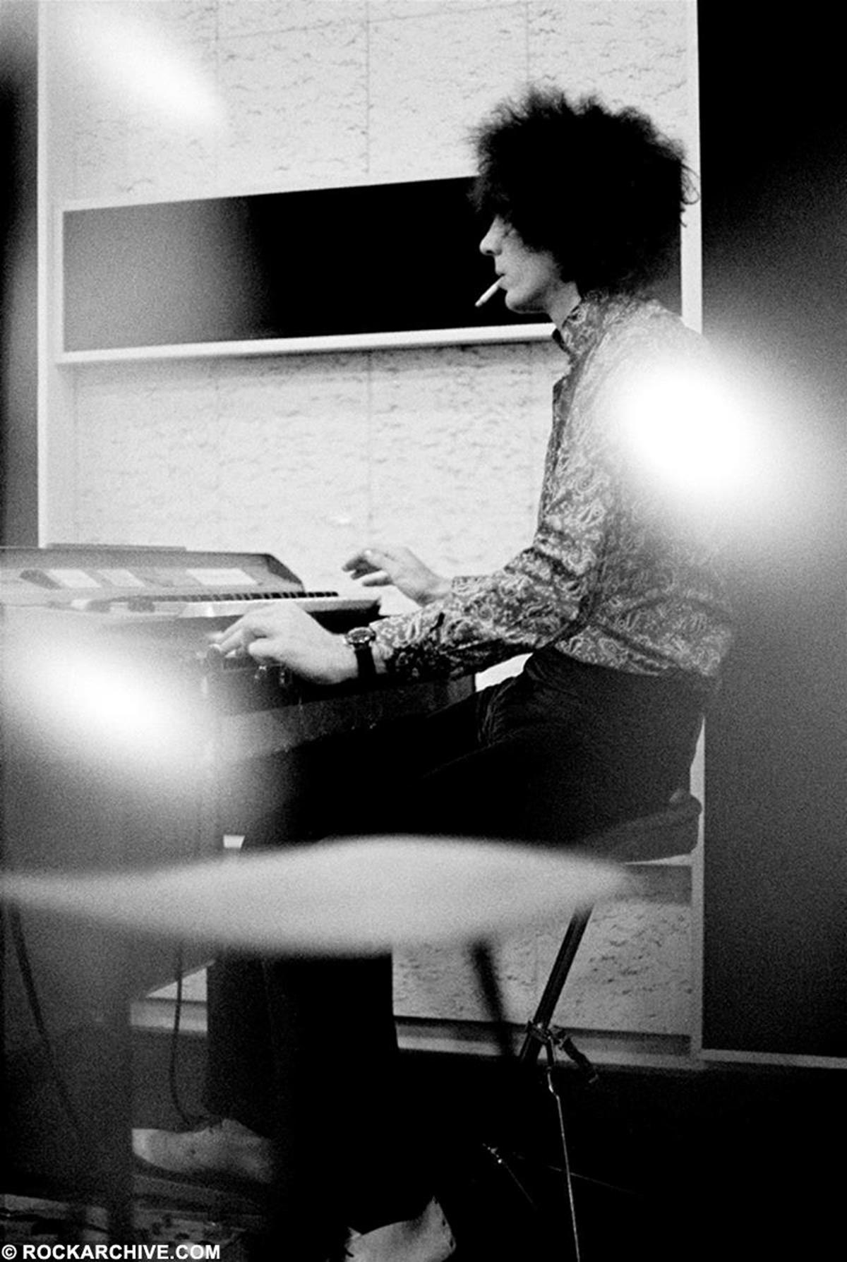 Syd Barrett captured in a candid moment at Abbey Road Studios whilst rehearsing for the recording of 'The Piper at the Gates of Dawn' in June 1967. © Andrew Whittuck