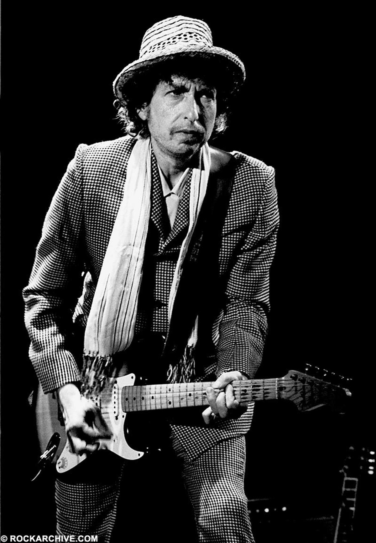 Bob Dylan performing onstage at the Arena Civica di Milano, Milan, Italy while on the 'Temples in Flames Tour'. He was supported on the tour by Tom Petty and the Heartbreakers. © Lex Van Rossen