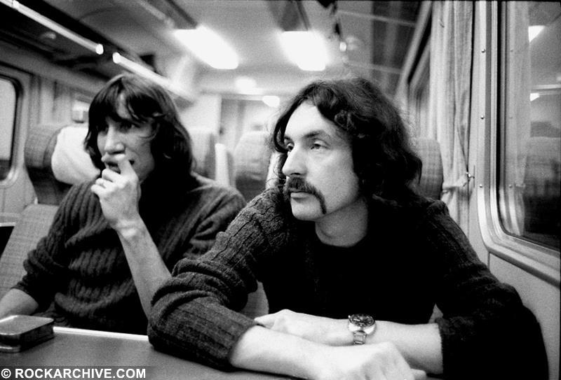 Roger Waters and Nick Mason on a train to Edinburgh during the 'Dark Side of the Moon' tour in 1974. © Jill Furmanovsky