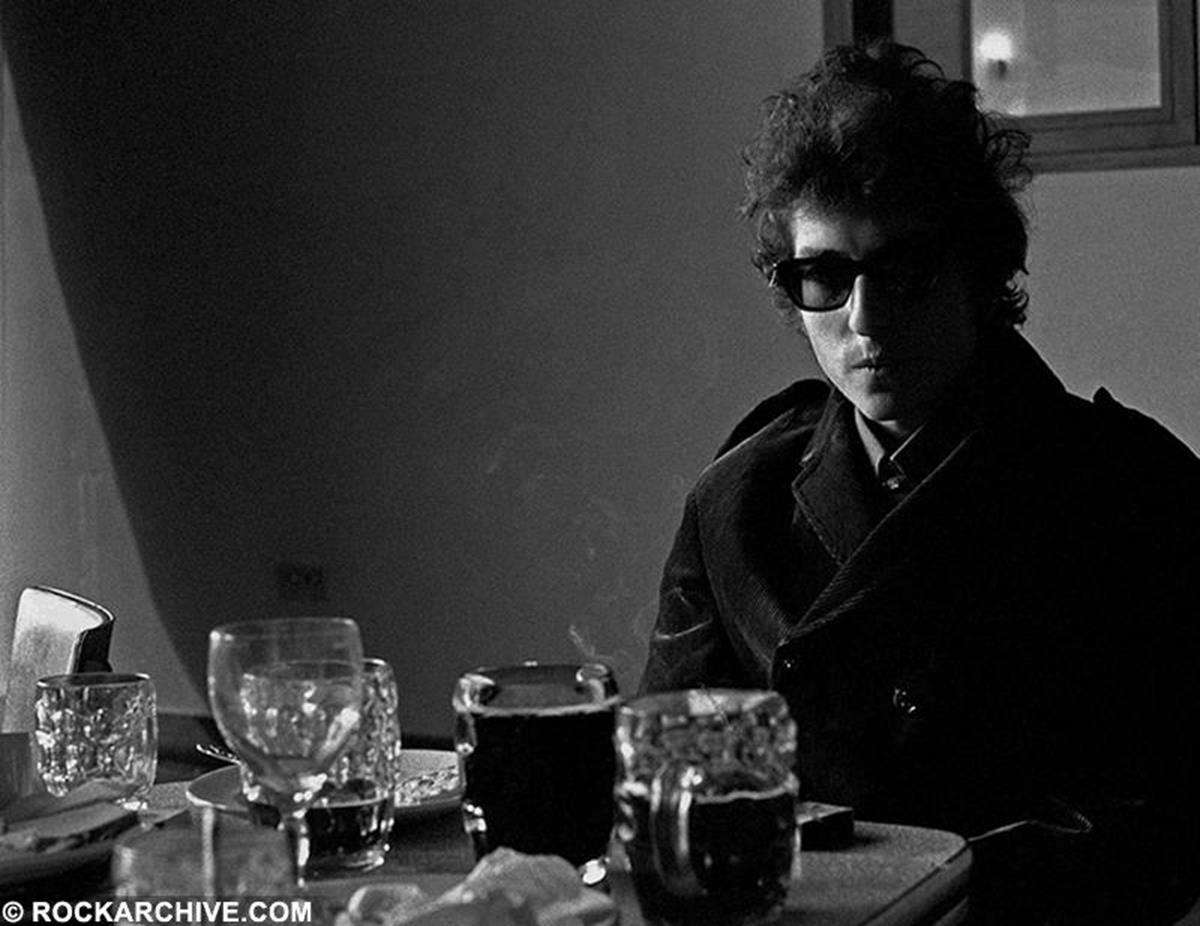 Bob Dylan relaxing, having a drink during the recordings for his BBC concert on 1st June 1965. © Barrie Wentzell