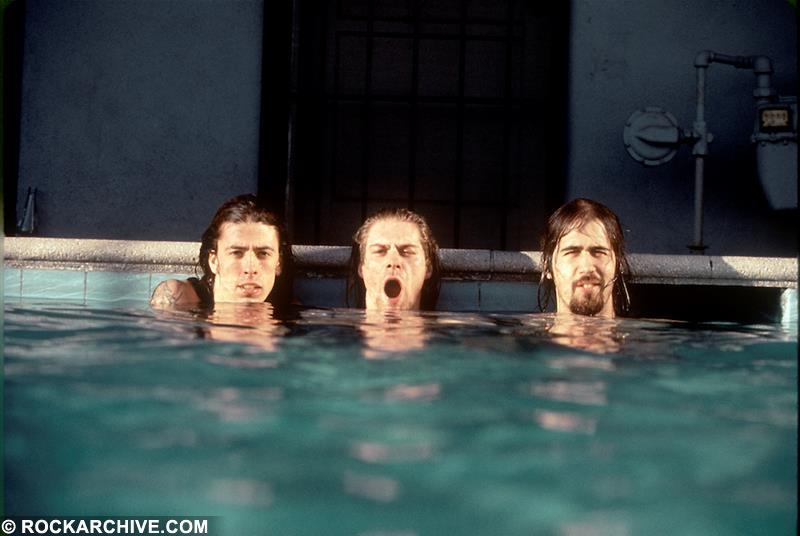 Nirvana captured during a publicity photoshoot for their pivotal album 'Nevermind', taken in a Los Angeles swimming pool. © Kirk Weddle