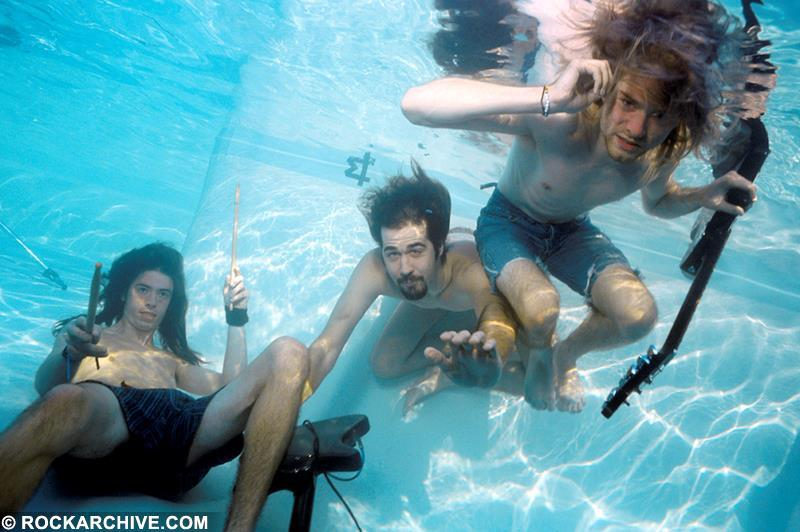 Kirk Weddle photograph of Nirvana playing instruments underwater in a Californian swimming pool in October 1991. © Kirk Weddle