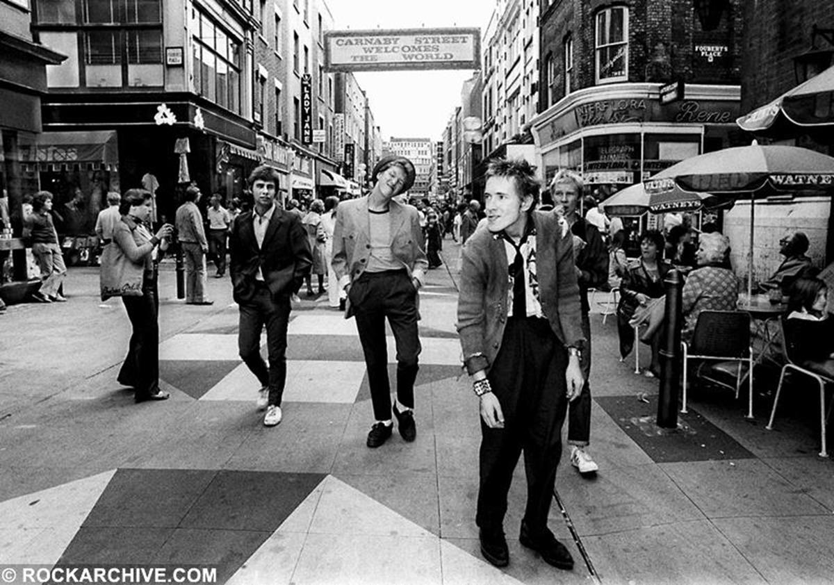 The Sex Pistols enjoying a stroll on Carnaby Street, London during the early days of Punk in 1976. © Ray Stevenson