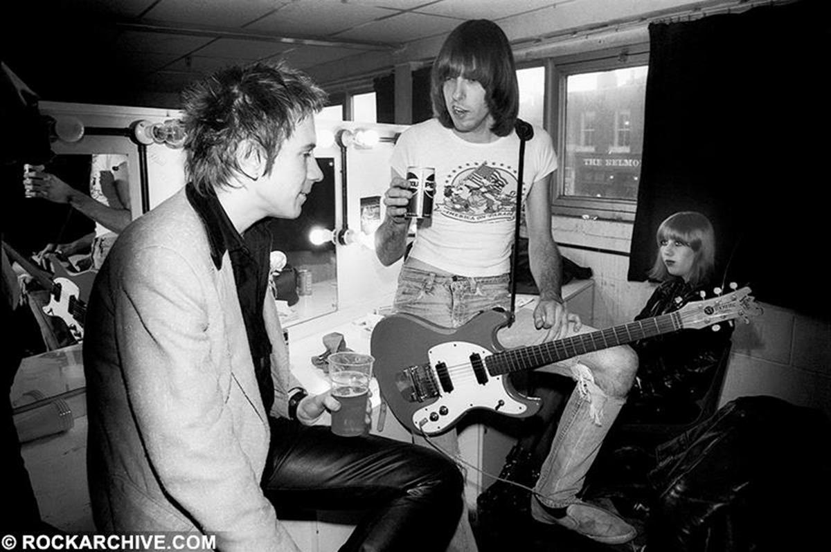 John Lydon aka Johnny Rotten with Johnny Ramone in a relaxed conversation backstage at The Roundhouse, London before a Ramones gig (with Talking Heads supporting) in June 1977. © Jill Furmanovsky
