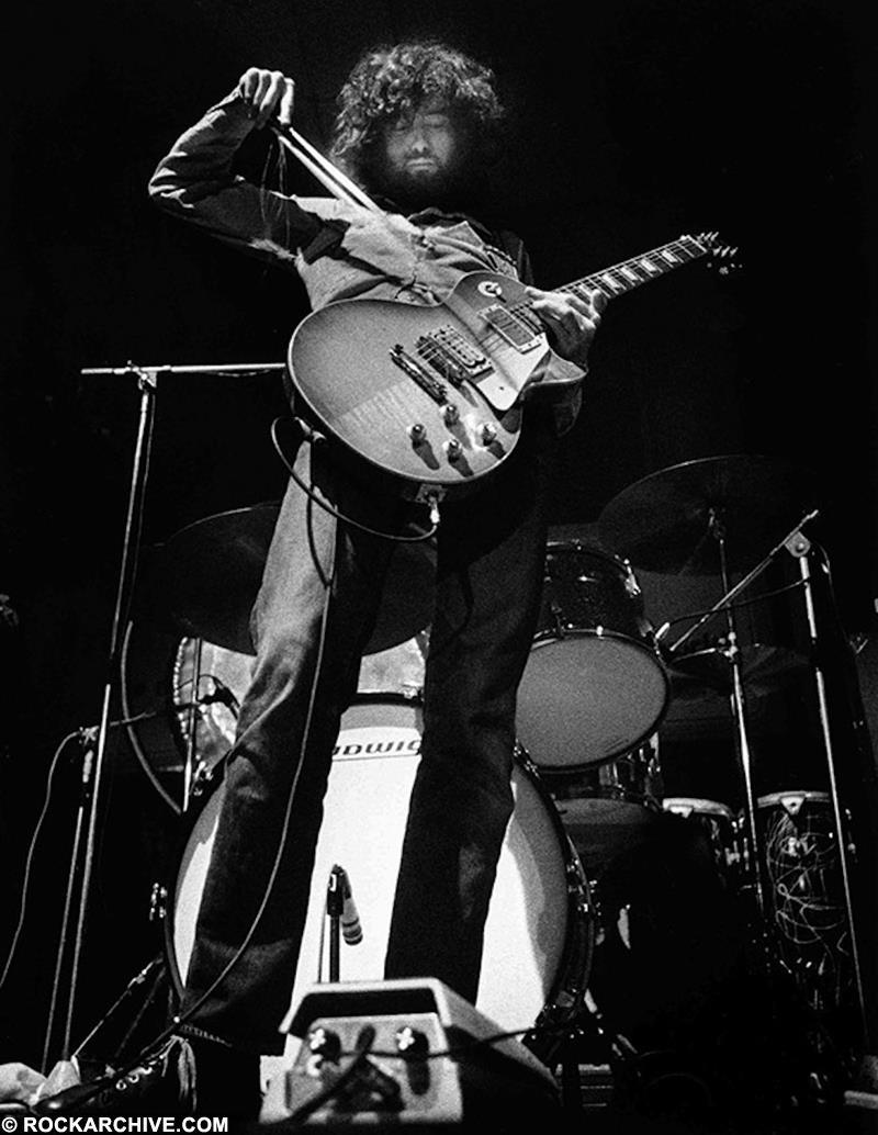 Jimmy Page playing his legendary bowed guitar solo during 'Dazed & Confused' whilst onstage with Led Zeppelin in Belfast in March 1971. © Barrie Wentzell