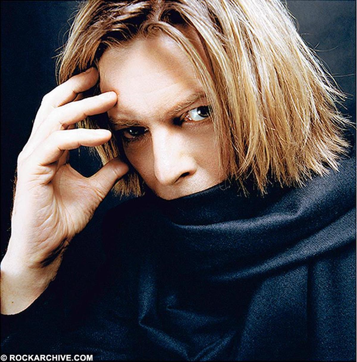David Bowie wearing a black scarf on a photo shoot in New York in 2002. © Mick Rock